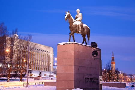 gustaf: Helsinki, Finland - February 12, 2011 Statue of Mannerheim with Finish Parlament and National Museum in the background. Seen early winter morning of February 2010. Carl Gustaf Emil Mannerheim was a president of Finland (1944-46). Editorial