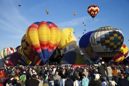 Albuquerque, New Mexico, USA - October 2, 2011 Hot Air Balloon Fiesta in Albuquerque, New Mexico. Crowd of the visitors observing the ascending balloons during clear fall morning. Stock Photo - 13789542