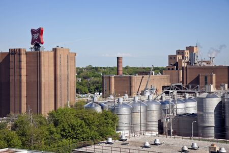 Milwaukee, Wisconsin, USA - August 24, 2011: Miller Brewing Company factory buildings in Milwaukee. Seen during summer afternoon with a blue sky from the roof of the building. Miller Brewing Company was founded in 1855.