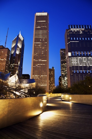 aon: Pedestrian Bridge and Chicago skyline during the sunset