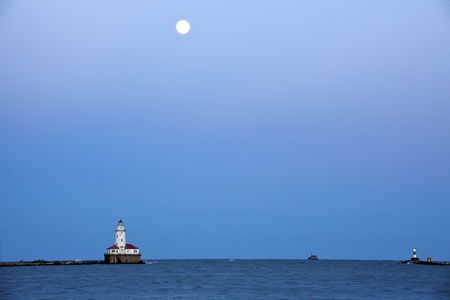 Full Moon rising above Lake Michigan and Chicago Lighthouse photo