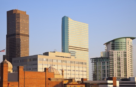 denver skyline at sunrise: Morning in Denver - warm light on downtown buildings Stock Photo