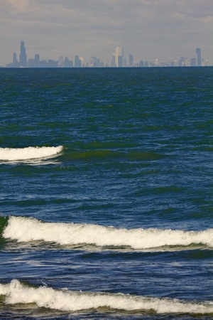aon: Distant view of downtown Chicago from Indiana, accross Lake Michigan.
