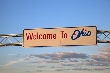 expressway: Welcome to Ohio road sign seen during sunset Stock Photo