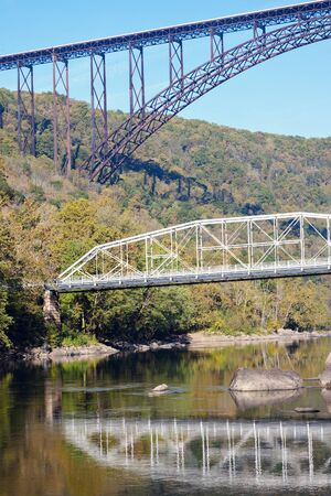 west virginia trees: Old and new - Bridges on New River in West Virginia Stock Photo