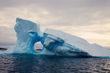 antarctic peninsula: Iceberg with the window - Antarctica. Antarctic Peninsula.