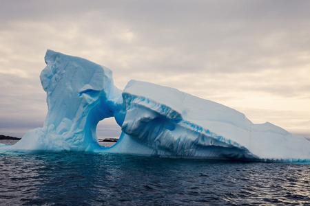 Iceberg with the window - Antarctica. Antarctic Peninsula.