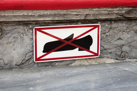 Take your shoes off - sign on the stairs to the temple. Bangkok, Thailand. Stock fotó