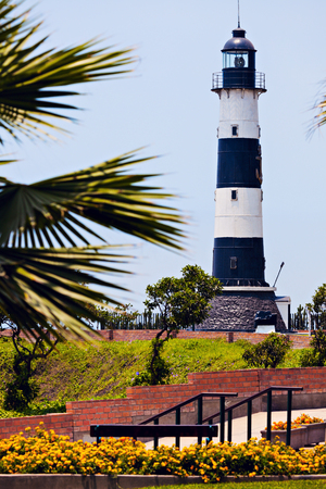 lima: Miraflores Lighthouse with palm tree - Miraflores, Lima, Peru Stock Photo