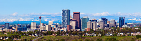 Panorama of Calgary and Rocky Mountains. Calgary, Alberta, USA Фото со стока
