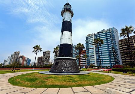 Miraflores Lighthouse with palm tree - Miraflores, Lima, Peru Stock Photo