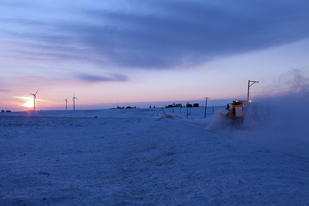 wind farm: Rural Illinois winter time - wind farm and snow plower Stock Photo