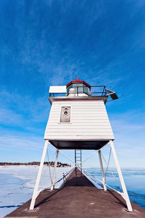 michigan snow: Two Harbors Breakwater Lighthouse winter time. Two Harbors, Minnesota, USA Stock Photo