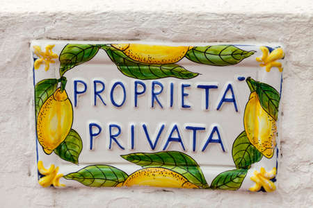private property: Private property sign on white wall. Amalfi Coast, Campania, Italy. Stock Photo