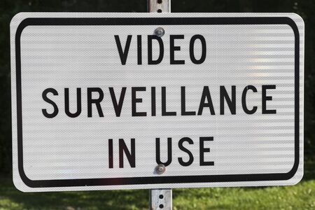sign in: Video surveillance in use - sign on white background Stock Photo