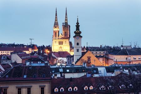 marys: Zagreb Cathedral and St. Marys Church in Zagreb at dusk. Zagreb, Croatia Stock Photo