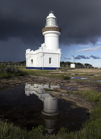 perpendicular: Point Perpendicular Lighthouse reflected in the pond. New South Wales, Australia. Stock Photo