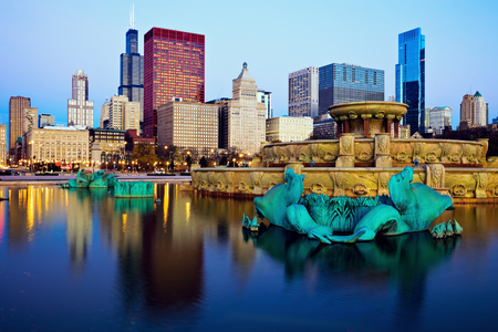 urban architecture: Chicago skyline reflected in Buckingham Fountain. Chicago, Illinois, USA.