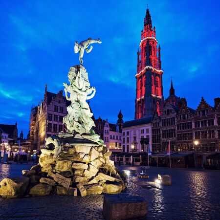 flemish region: Brabo Fountain and Cathedral of Our Lady on Grote Markt in Antwerp. Antwerp, Flemish Region, Belgium