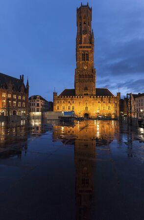 flemish region: Belfry of Bruges reflected during the rain. Bruges, Flemish Region, Belgium