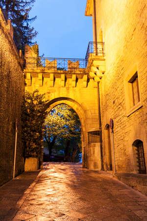 san marino: Arch gate in San Marino at dusk. San Marino, San Marino Stock Photo