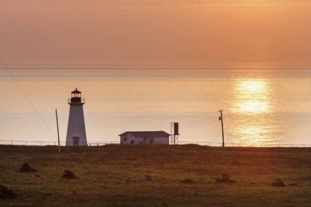 scotia: Enragee Point Lighthouse at sunset. Nova Scotia, Canada