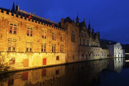 flemish region: Houses and canals in Bruges at night. Bruges, Flemish Region, Belgium