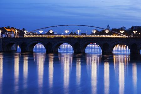 meuse: Bridge on Meuse River in Maastricht. Maastricht, Limburg, Netherlands.