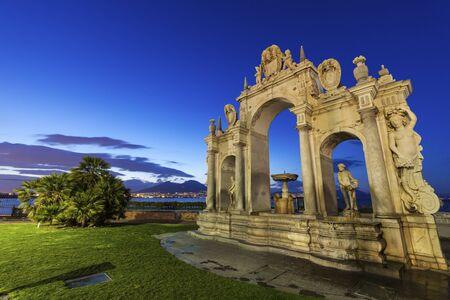 Immacolata Fountain in Naples. Vesuvius in the background. Naples, Campania, Italy Banco de Imagens