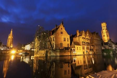 flemish region: Belfry of Bruges reflected in the canal. Bruges, Flemish Region, Belgium