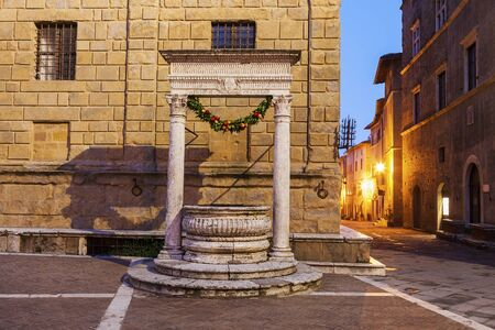 Well in old town of Piazza. Pienza, Tuscany, Italy