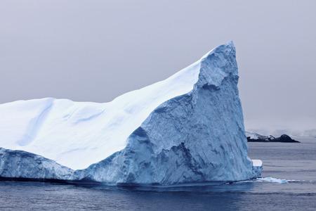polar climate: Antarctica landscape - iceberg floating in the sea