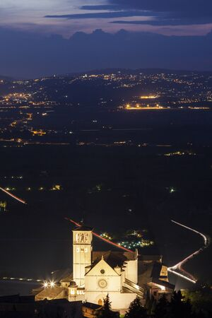 Basilica of St. Francis of Assisi at night. Assisi, Umbria, Italy Stock Photo - 54893043