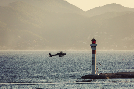 alpes maritimes: Lighthouse and landing helicopter in Cannes. Cannes, Provence-Alpes-Cote dAzur, France