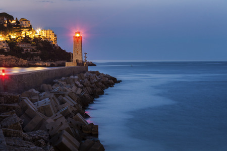 french riviera: Nice Lighthouse at sunrise. Nice, French Riviera, France. Stock Photo