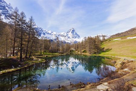 aosta: Matterhorn reflected in Blue Lake Breuil-Cervinia, Aosta Valley, Italy.