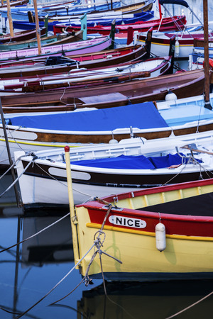 alpes maritimes: Nice port - colorful fishing boats. Nice, French Riviera, France. Stock Photo