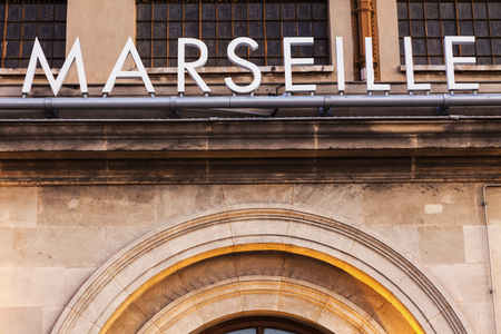 france station: Marseille sign seen on the railway station building. Marseille, Provence-Alpes-Cote dAzur, France. Stock Photo