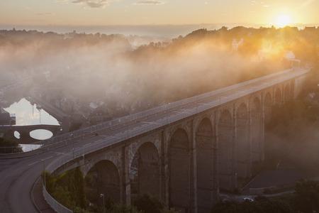 rance: Sun rising over Port de Dinan in Dinan. Dinan, Brittany, France