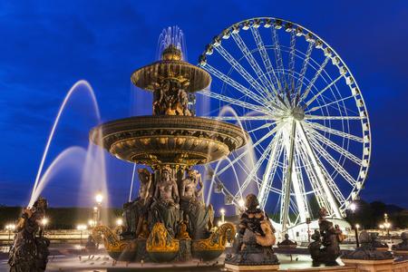 Fontaine des Fleuves and Ferris Wheel on Place de la Concorde in Paris. Paris, France.