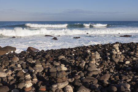 Stone piles on the beach in Puerto de la Cruz. Tenerife, Canary Islands, Spain.