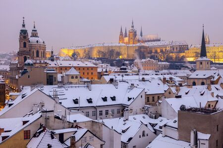 Winter in Prague - city panorama with St. Vitus Cathedral  and St. Nicholas Church. Prague, Bohemia, Czech Republic. Banco de Imagens - 74299340