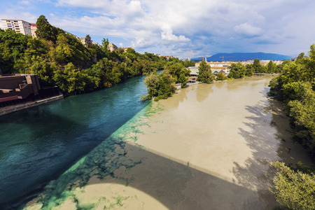 confluence: Confluence of the Rhone and Arve Rivers in Geneva. Geneva, Switzerland. Stock Photo
