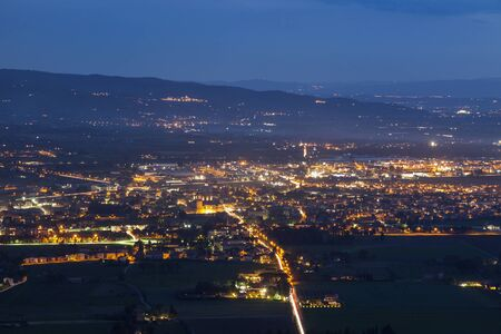 night dusk: Panorama of Assisi at night. Assisi, Umbria, Italy. Stock Photo