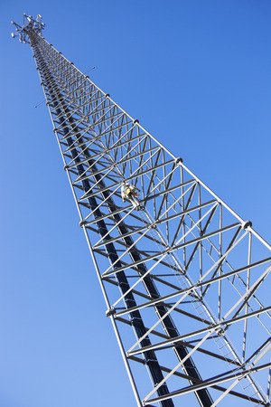 Climber ascending the cellular tower. Illinois, USA.