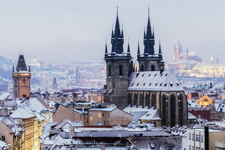 Winter in Prague - city panorama with Tyn Cathedral and Clock Tower. Prague, Bohemia, Czech Republic.