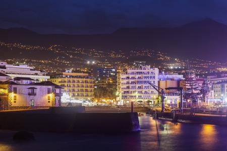 Puerto de la Cruz at night and Teide in the background Puerto de la Cruz, Tenerife, Canary Islands, Spain.