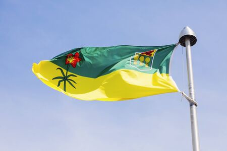 Saskatchewan flag against blue sky. Regina, Saskatchewan, Canada.