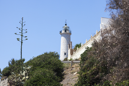 Calaburras lighthouse on the hill. Fuengirola, Andalusia, Spain.