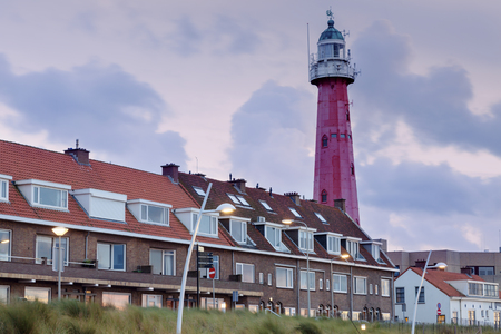 Scheveningen Lighthouse at sunset. Scheveningen, South Holland, Netherlands.